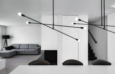 The architects employed a restrained colour palette of white, black and grey – with wooden finishes lending a sense of warmth to austere rooms