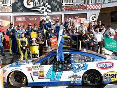 AJ Allmendinger celebrates after winning the Cheez-It 355 at Watkins Glen International on Aug. 10. Allmendinger's first career Sprint Cup Series win clinched an unlikely berth in the Chase for the JTG-Daugherty Racing driver.