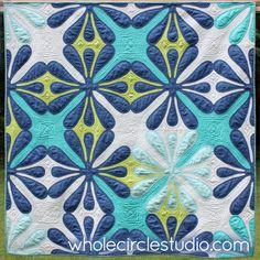 Big Island Blossom quilt designed, pieced and quilted by Sheri Cifaldi-Morrill | Whole Circle Studio. Shown at QuiltCon 2017 in Savannah, Georgia.