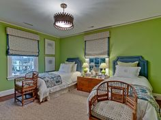 love the barrel back chairs at the foot of twin beds; from Bryn Alexandra via House Beautiful