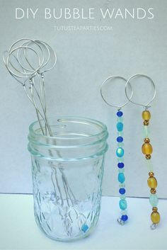 DIY bubble wand craft from Tutus and Tea Parties cute little craft idea for the guests to do. Just put bowls of colorful beads on the tables and small mason jars of bubbles that they can take home