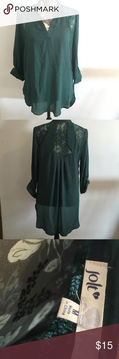 Jolt jade green blouse Jolt jade green/teal blouse. Longer in the back. Sleeves can be rolled up. Lace accents. Brand new without tags. Jolt Tops Blouses