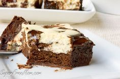 <em> These Amazing CheesecakeBrownies are flourless, low carb, sugar free, gluten free and grain free! </em>   It's July!! I can't even believe how fast the summer is flying by since school finished. Right now we are all about pool parties and easy food and treats to enjoy fun times with family and friends. What my kids love most is brownies. And cheesecake. So I married them and made these!   This year I'...