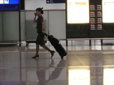 Stewardess traversing the polished floors of the terminal