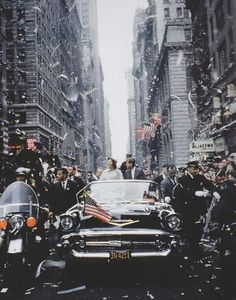 1960. Senator John F Kennedy and his wife Jacqueline Kennedy campaign during a ticker tape parade in Manhattan, New York City.