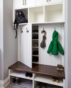 Our creative mudroom design features hidden shoe storage cabinets behind panelle. - Our creative mudroom design features hidden shoe storage cabinets behind panelled doors dressed wit - Entryway Shoe Storage, Entryway Closet, Diy Shoe Storage, Bedroom Storage, Shoe Cubby, Hidden Storage, Ikea Entryway, Closet Doors, Closet Mudroom