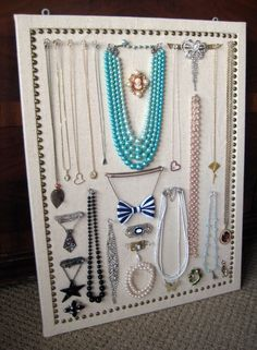 I made this jewelry display board out of a simple cork board, fabric & decorative nail heads. Super easy DIY project. :)