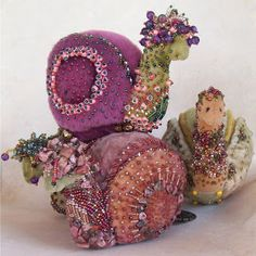 Oh! snails! love the encrusted beadwork on wool felt(?).....looks to be shaded wash on the fabric.