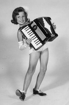 Tana Carli, future TV 8 Anchor, playing accordion on Gene Carroll Show on TV5