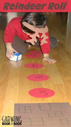 alphabet activities: this reindeer roll game will have the kids moving and learning their letters and sounds from growingbookbybook.com
