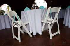 bride & groom wooden signs with ribbons on chairs - elizabeth larson photography