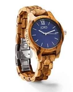 Frankie 35 Series Watch in Zebrawood & Navy (Unisex) Minimalism has never equated to more. Settle into the calm and collected pairing of deeply grained zebrawood and anchoring navy blue. Your time is