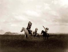 You are looking at an educational picture of Sioux Warriors on Horseback. It was taken in 1905 by Edward S. Curtis.