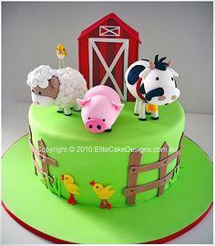Farm animals in a barn yard birthday cake