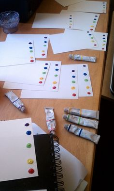 make-your-own paint-with-water pages. Use tubes of water-color paint and watercolor paper. Dot the bottom, let dry. To use, just dip brush in water and paint!!