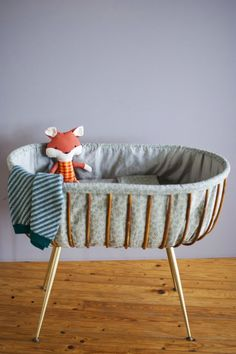 Bamboo and Brass Bassinet.