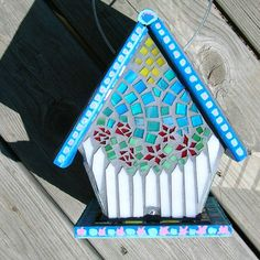 Back view of a mosaic birdhouse I did. I called it my white picket fence birdhouse.