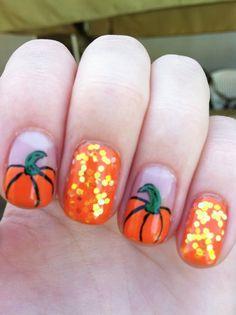 Fall pumpkin nail art, love the sequins nails