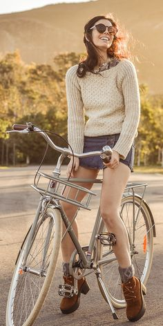 Elle-May Leckenby - Sheinside Denim Skort, Sheinside Blue And Cream Rose Print Cotton Tee, Diamond Link Socks, Zerouv Round Retro Sunglasses, Lekker Bikes Sportief Retro Mens Slate Grey Bike, Design Dope Cream Knit Sweater - Afternoon ritual