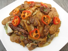 Stir-fry Rice Cake with Roast Pork and Clam