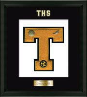 Trumbull High School in Connecticut Varsity Letter Frame - Showcase your varsity letter in our Omega solid hardwood shadowbox frame in black satin finish with hand embossed Trumbull High School logo, on our black and white museum quality matting. A personalized engraved plate is included.