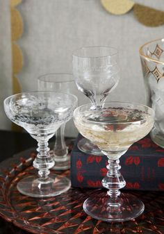 Vintage champagne glasses--worth every cent. great for cocktails, etc.