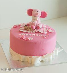 Pink fondant cake with elephant, baby, bowl and flowers. www.tekila.fi