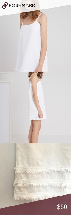 The Fifth Label White Dress White Dress Size M The Fifth Label is an Australian women's clothing brand morphing high fashion with bold street wear tailored for the modern era.  -Loose fit  -Scooped neckline  -Neck and armhole facing  -Rigid denim  -Frayed hem detail The Fifth Label Dresses Mini