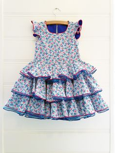 Cute dress with flower leaf print and flamenco accents in EU size 122. This dress is suited for girls around the age of 5.