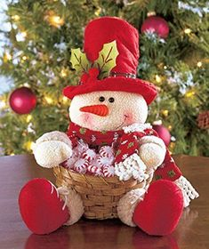 Plush Character Basket looks cute on tables, counters or buffets. He wears a holiday hat with holly and fabric accents and holds an attached bamboo basket that' Snowman Christmas Decorations, Snowman Crafts, Christmas Snowman, Christmas Stockings, Diy And Crafts, Christmas Crafts, Christmas Ornaments, Holiday Hats, Holiday Decor