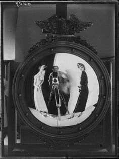 Martin Munkácsi - Self-Portrait - Reflected image of Munkacsi and two women, undated. S)