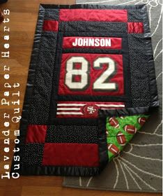 Lavender Paper Hearts: Custom Ordered Quilt. She made it from an old football jersey.