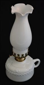 """This milk glass oil lamp adds a dainty touch to a rustic style.  In near perfect condition, the milk glass has an elegant design and is held together with beautiful brass detailing.   Measures  a dainty 11"""" in height."""