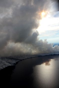 An aerial view of the Lateral West Fire in the Great Dismal Swamp National Wildlife Refuge looking westward from above Lake Drummond late in the afternoon Thursday, August 11, 2011.
