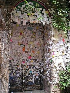 The house of Giulia and Romeo in Verona, Italy .. Numerous stick notes can  be found on the walls and doors in the courtyard...love notes..