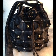 NWOTBucket Crossbody Bag w/ Brass Studs & Stones Chic & Unique! Black faux leather drawstring bucket messenger bag. Embellished with clear crystals and brass studs. Triangular cuts give visual interest and depth. Totally unique! Long adjustable strap.  boutique Bags Crossbody Bags
