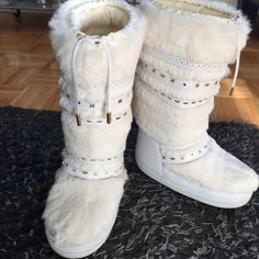 Celine Fur Moon Boot Authentic Celine White Fur Moon Boot.  Size = Sole Marked 35-37.  Could fit 5/5.5/6.  Worn Once on Snow.  See Pic for Some Wear from One Time Use.  Overall the Boots are in Great Condition.  Stored in Plastic.  No Dust Cloths. No Box.  Purchased in NYC in early 2000s.  Perfect Find for a Celine Collector.  As a Moon Boot, Very Cushiony Inside. Like Walking on the Moon!  Not Sure I Want to Part With Them! Celine Shoes Winter & Rain Boots
