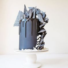A birthday cake for a girl who likes black + white. Beneath the black vanilla buttercream reveals layers of red velvet with white chocolate buttercream #cakesbycliff #monochrome