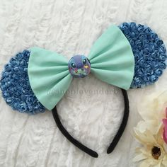 Stitch with Scrump Floral Ears by Shoplavenderb on Etsy https://www.etsy.com/listing/252292925/stitch-with-scrump-floral-ears