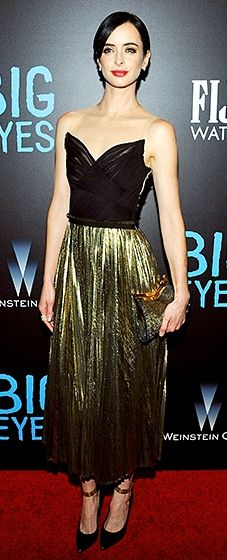 Krysten Ritter looked sophisticated in a J. Mendel ensemble with a pleated gold skirt.