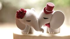 Share your story. The elephant pair is specially handmade to embrace each other. Representing a special and loving bond. The closed eyes convey a sweetness between the couple. This is an unforgettable cake topper just like your wedding day!  ~~~~~~~~~~~~~~~~~~~~~~~~~~~~ HERE IS THE FULL VALUE OF YOUR CAKE TOPPER ~~~~~~~~~~~~~~~~~~~~~~~~~~~~  FEEL SAFE - fast, easy and friendly service. WARRANTY AGAINST MAYHEM - receive FREE 3 month warranty after receiving your cake topper on accidental…
