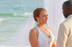 Beaded chiffon halter gown, with gorgeous earrings and turquoise water in the background--picture perfect!