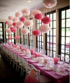 Make the centrepiece colourful! - here pink is used both as table decorations  but also ceiling drapes to create a greater effect