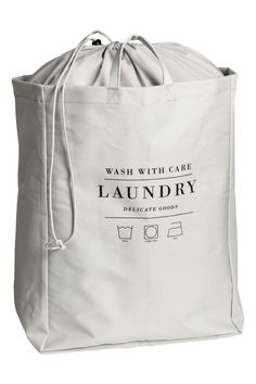 Small laundry bag in cotton twill with printed text, two handles, and plastic coating inside. Top section in lighter-weight fabric with a Laundry Shop, Small Laundry, Laundry Rooms, Laundry Business, Hm Home, Plastic Coating, Bag Packaging, Laundry Service, Fabric Bags