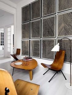 Love the Mid-Century moulded warm wood contrasting with the graphic almost tribal abstraction....k