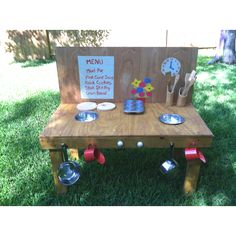 Outdoor play kitchen for making mud pies! $5 for scrap wood at homedepot, $10 at the dollar store for pots, bowls, etc, paint/knobs/hooks we had.