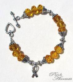 US Soldier/Troop Support: Yellow Glass and Sterling Silver Plated Bracelet, 7.75 inches.  30% of your purchase price goes directly to the USO (United Service Organizations)!  The USO is a private, nonprofit, non-partisan organization whose mission is to support the troops by providing morale, welfare and recreation-type services to United States Troops and their families.