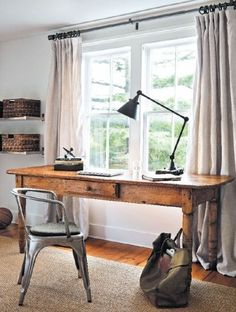 Love the warmth the wood desk adds, and the industrial light juxtaposition is great.