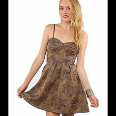 Free People Multi Color Floral Tapestry Dress Charm them all in this florid, feminine Free People™ dress.  Sleeveless minidress boasts an artful floral print throughout.  Bustier bodice provides shape and flatters feminine curves.  Tonal stitching accentuates the sweetheart neckline and set-in waist.  Gentle pleating at full skirt.  Side zip closure.  Smocked back panel provides a secure fit.  May be worn with or without adjustable spaghetti straps.  Fully lined.  100% polyester;  Lining…