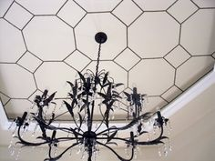 "From the ground, this ceiling featured on Design*Sponge appears to be covered in tiles, but upon closer inspection, the ""grout lines"" are actually nailhead trim.   So Long, Popcorn Ceilings: 8 Transformative Overhead Architectural Hacks"